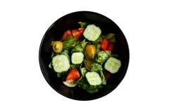 Изолированная плита с салатом стоковое фото