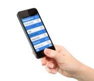 Изолированная рука женщины держа телефон с фактически бумажником Стоковое фото RF