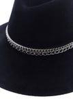 Изолированная черная шляпа шерстей на белом стиле моды предпосылки Стоковая Фотография RF