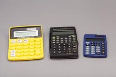 3 изолированного калькулятора Стоковое Изображение