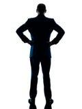 Изолированное вид сзади бизнесмена стоящее Стоковые Изображения
