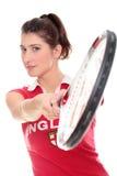Изолированное изображение студии от молодой женщины с ракеткой тенниса стоковые изображения
