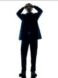 Изолированное отчаяние положения бизнесмена Стоковое фото RF