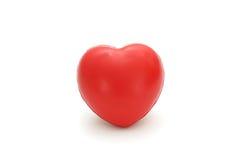Изолированное одиночное простое красное сердце губки на белой предпосылке Стоковые Изображения