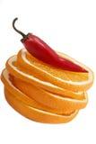 Изолированные апельсин и chili Стоковая Фотография