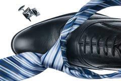 Изолированные ботинки конца-вверх черные и голубая связь, Стоковая Фотография RF
