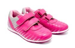 Изолированные ботинки спорта детей розовые Стоковые Изображения