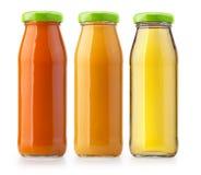 Изолированные бутылки апельсинового сока Стоковая Фотография
