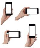 Изолированные женские руки держа умный телефон иллюстрация штока