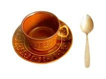 Изолированные кофейная чашка и ложка стоковое изображение rf