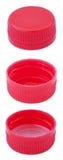 Изолированные красные пластичные крышки бутылки Стоковое Изображение