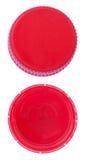 Изолированные красные пластичные крышки бутылки Стоковая Фотография