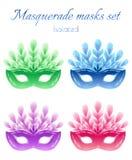 Изолированные маски masquerade установленные на белую предпосылку Стоковое фото RF