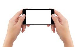 Изолированные руки человека 2 держа черный передвижной smartphone Стоковое Фото