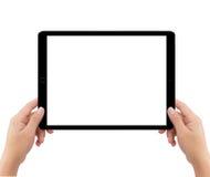 Изолированные руки человека 2 держа черный планшет Стоковые Изображения