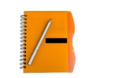 Изолированные тетрадь и карандаш Стоковое фото RF
