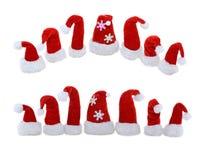 Изолированные шляпы Santas Стоковое Фото