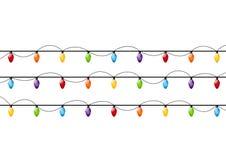 Изолированные электрические лампочки рождества Стоковые Фото