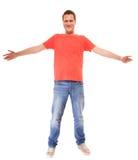 Изолированные jaens футболки непринужденного стиля парня молодого человека красные Стоковые Фото