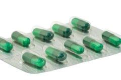 Изолированные microgranules капсулы волдыря зеленые Стоковое фото RF