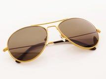 изолированный желтый цвет солнечных очков белый Стоковое Изображение RF
