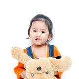 Изолированный милый ребёнок с куклой собаки Стоковое фото RF