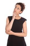 Изолированный молодой милый думать бизнес-леди стоковое изображение rf