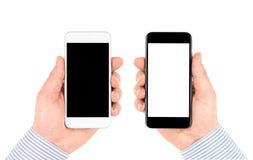 Изолированный на белых руках держа smartphones с пустым экраном Стоковая Фотография
