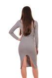 Изолированный портрет красивой девушки в платье от задней части Стоковое Фото