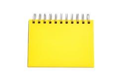 изолированный предпосылкой желтый цвет тени страницы тетради белый Стоковое фото RF