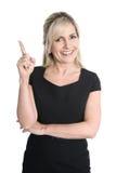 Изолированный привлекательный успешный женский менеджер представляя с ним стоковое изображение rf