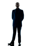 Изолированный силуэт бизнесмена стоящий Стоковое фото RF