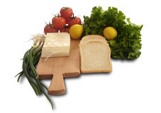 Изолированный томат, лимон, салат, хлеб, свежий лук салата и сыр Стоковая Фотография RF
