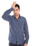 Изолированный человек при голубая отжатая рубашка сотрясенная и стоковое фото rf
