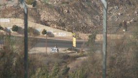 Израиль, около 2011 - граница Израиля Ливана с столбами и флагами Хезболлы видеоматериал