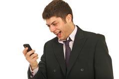 изумил его мобильный телефон Стоковое Изображение RF