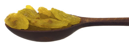 Изюминки в деревянной ложке Стоковые Фотографии RF