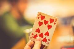 10 из сердец в руке женщин везение игры карточки 4 туза Стоковые Фото