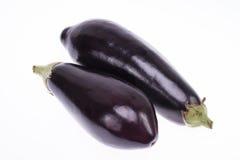 2 из черных баклажанов изолированных на белой предпосылке Стоковая Фотография RF