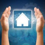 Икона дома в руке стоковое изображение rf