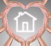 икона дома сердца руки стоковые изображения