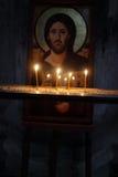 Икона Иисуса и свечек стоковые изображения