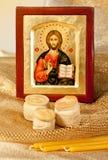 Икона Христоса и хозяина и свечек хлеба вероисповедания Стоковое Изображение RF
