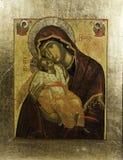 Икона Eleousa грека в золотистой рамке стоковое изображение rf