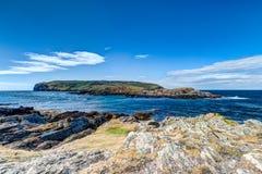 Икра острова человека с скалистым передним планом Стоковые Фото