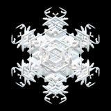 Иллюстрация белой симметричной снежинки изолированной на черноте бесплатная иллюстрация