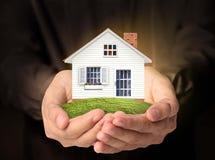имущество принципиальных схем вручает дом реальную Стоковые Фото