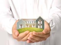 имущество принципиальных схем вручает дом реальную Стоковые Изображения RF