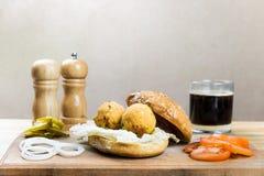 Ингридиенты бургера Vegan на деревянной таблице Стоковое Изображение