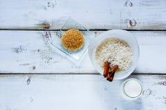 Ингридиенты для делать рисовый пудинг Стоковая Фотография RF
